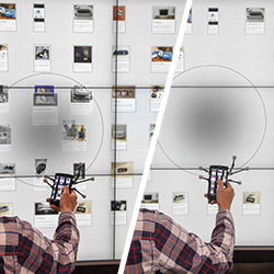 FlowTransfer: Content Sharing Between Spatially-Aware Mobile Phones and Large Vertical Displays