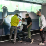 Miners: Communication and Awareness in Collaborative Gaming at an Interactive Display Wall
