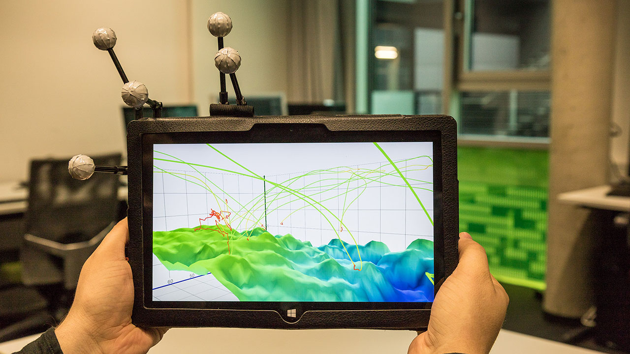 Accompanying video to our paper 'Investigating the Use of Spatial Interaction for 3D Data Visualization on Mobile Devices'. The thumbnail shows a tracked tablet displaying a mixed reality visualization of a 3D height map.